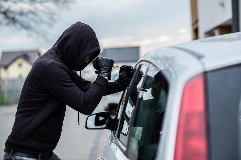 bigstock-car-thief-trying-to-break-into-129418745